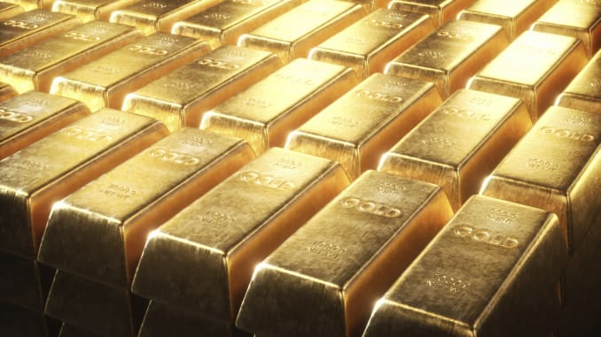 Gold muted on firmer dollar, heads for worst week in over a month