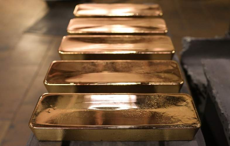 Gold is at a an all-time high. Should you buy, sell or wear it?