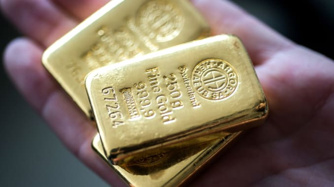 Gold firms on softer dollar, concerns over rising virus cases