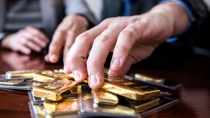 Gold gains on dollar slide as U.S. election drags on