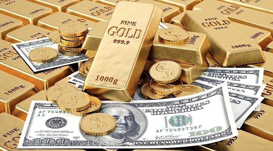 Gold prices tumble, U.S dollar up