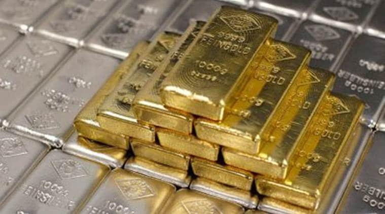 Gold hits one-week high as dollar eases, pandemic worsens