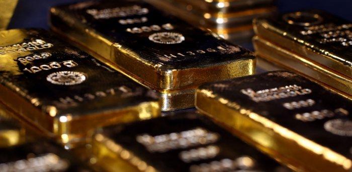 Gold rises marginally, silver gains Rs 451